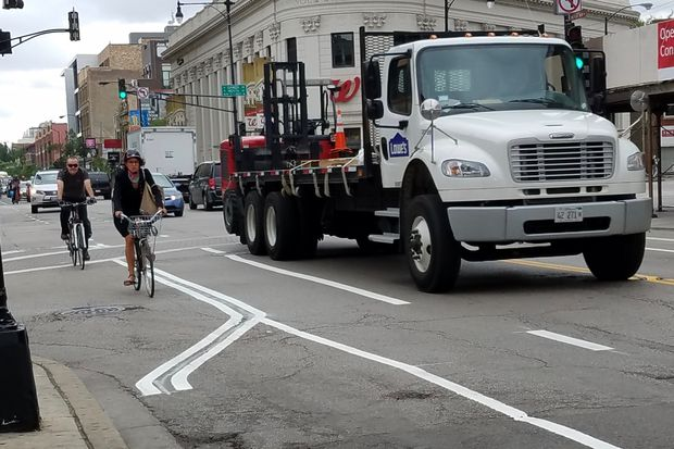 "New ""dashed"" bike lanes debuted along Milwaukee Avenue this week as part of a pilot program."