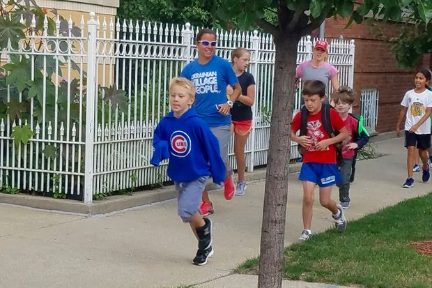 Students jogged to school with physical education teacher Tracy Roessner early Friday.