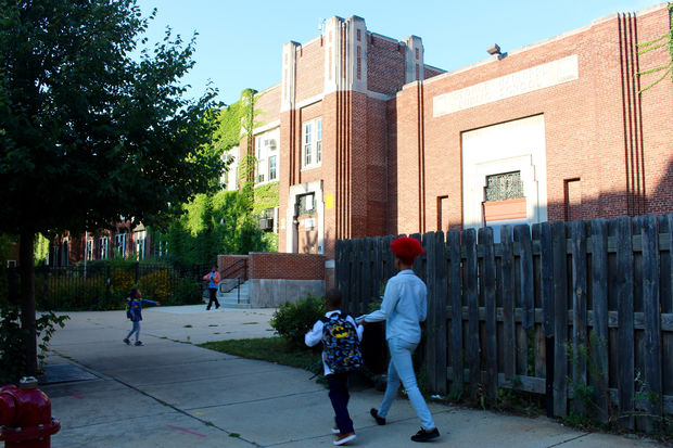 Parents usher their kids to school at Manierre Elementary.