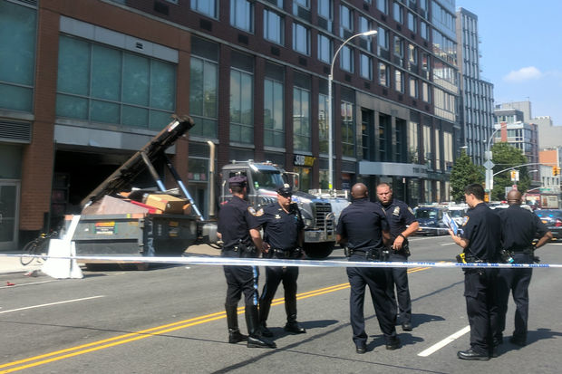 The garbage worker was hit by a red Honda Civic on Chrystie Street, sources said.