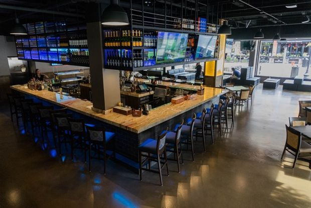 "From the mind of a former ""Bachelorette"" contestant, this upscale sports bar is open near University of Illinois at Chicago."