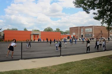 Students at recess play outside the new eight-classroom module built behind Bridge Elementary School, 3800 N. New England Ave.