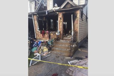 The fire broke out inside a home on 147th Street near Rockaway Boulevard early Friday, the FDNY said.