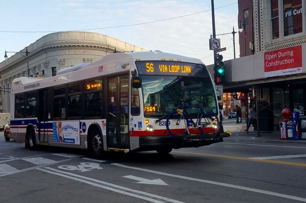 Some bus stops will be relocated as part of a pilot project that added dashed bike lanes on Milwaukee Ave.