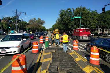 A Department of Transportation crew works to replace pedestrian islands on Eastern Parkway and Kingston Avenue on Friday morning.