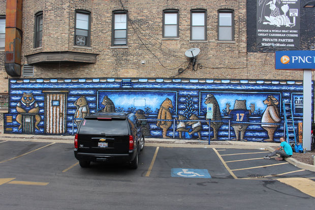 Street artist Sick Fisher puts the finishing touches on a Chicago Bear mural on the wall of the Wild Hare, 2610 N. Halsted St.