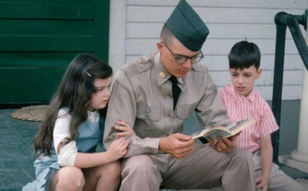A soldier from the Vietnam War era with his children.