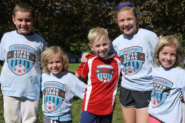Cormac Friedlander (center) poses with family members during a spring Chicago SuperStars TopSoccer practice.