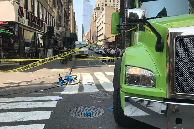 The truck driver was turning right when he hit the cyclist and ran over her leg, a witness said.