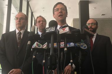 Attorneys for the city, led by Corporation Counsel Ed Siskel, center, blasted the Trump administration's actions, saying their effort was
