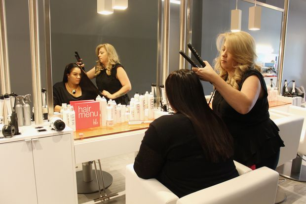 Blower Jessica Martell styles blow boss Ciara Delgado on Monday, the first day Blo Blow Dry Bar was open for business at 3821 N. Southport Ave. The salon will have its grand opening party from noon to 2 p.m. on Friday, and specials are offered all week.