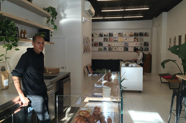 Brian Thomas stands inside The Mixtape Shop, a new record store and cafe at 1129 Bedford Ave. in Bed-Stuy.