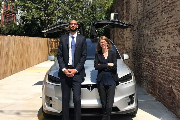 Ideal Properties agents Noel Borbon and Jennifer Rhodes are throwing  in a Tesla with the 2-family townhouse at 307 Van Brunt, which is priced at $2.995 million.