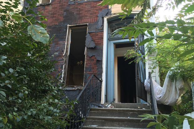The four-story building at 952 Bedford Ave. was left badly burnt a day after police ejected a group of squatters, according to a police spokesman.