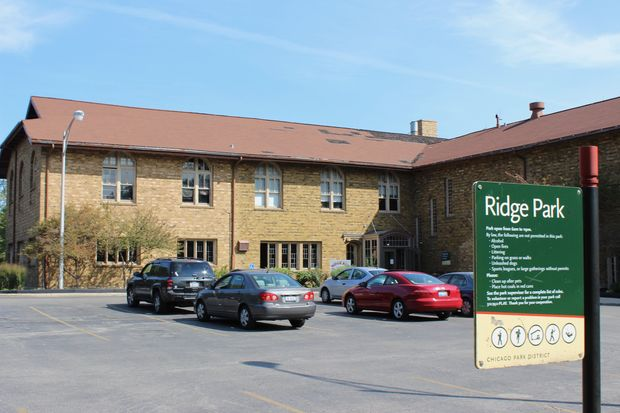 Roofing contractors gathered Tuesday morning to survey to sprawling roof at Ridge Park in Beverly. A park district official said work will begin by Oct. 15 and could be complete by Dec. 15.