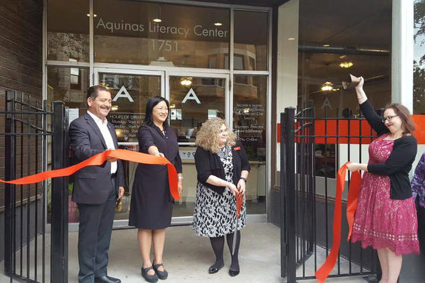 Cook County Commissioner Chuy Garcia and State Rep. Theresa Mah celebrate the opening of the new Aquinas Literacy Center along with center officials on Friday.