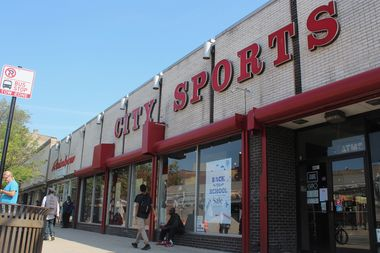 The 197-unit development would establish a nine-story, 103-foot tall building in place of the building housing City Sports, Wilson Optical, Family Dollar and Rainbow shops.