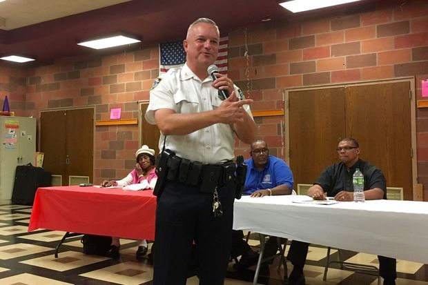 Inspector John Cappelmann, commanding officer of the 103rd Precinct, discusses crime statistics at a community council meeting Tuesday night.