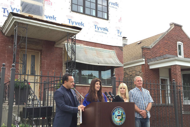 Ald. George Cardenas (12th), Building Commissioner Judy Frydland, and homeowners Neringa and Dennis Venslavicius discuss the streamlined home renovation permitting process at a news conference Wednesday in McKinley Park.