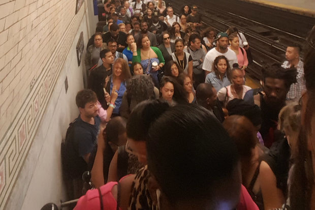 Commuters crowded onto the platform at the 168th Street station.