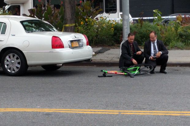 The car driver hit the cyclist near Utica Avenue and Empire Boulevard, police said.