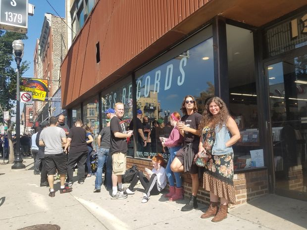 As of 8 a.m. Thursday, people began lining up at the record store to get a chance to see an intimate Q&A with the band.
