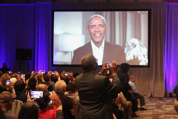 About halfway through the community meeting, where Obama Foundation officials updated the community and received feedback from the public, the former president dropped into the meeting via satellite, surprising and delighting the hundreds in attendance.