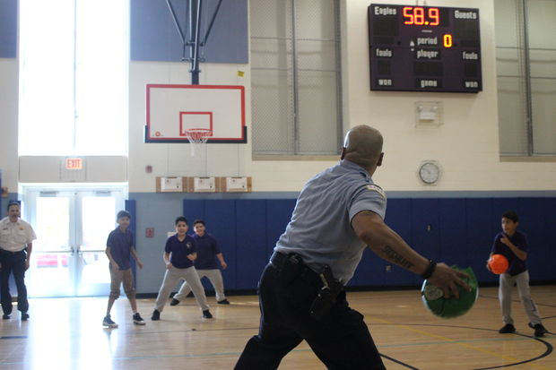 Chicago police officers assigned to Safe Passage patrols play a game of dodge ball with Shields Elementary 7th graders Friday in Brighton Park.