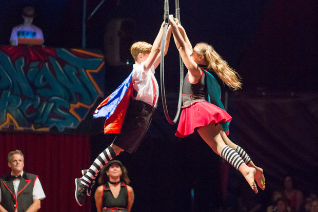 Max (left), 12, and Samantha Rae Jenkins, 10, perform together at the Midnight Circus. The two have been a part of their parents' circus for most of their lives.