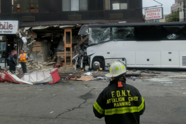 A Dahlia bus crashed into the tail of an MTA bus and then a Flushing storefront, killing three people including its own driver, officials said.
