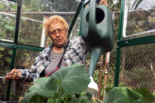 Jenny Benitez helped transform a forgotten corner of Manhattan i nto a blossoming garden.