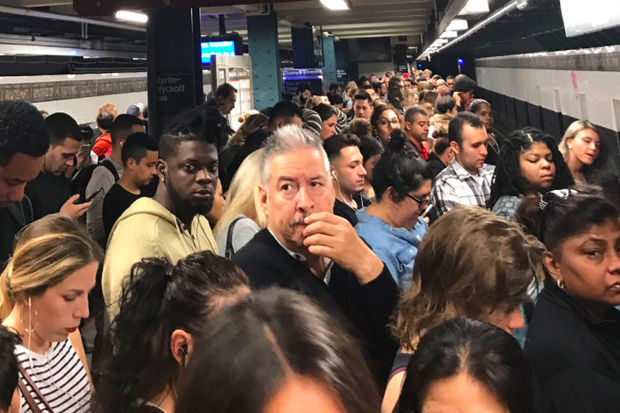 Miserable riders waited for the L train at Myrtle-Wyckoff during the Thursday morning rush, as captured by commuter Ali Philippides.