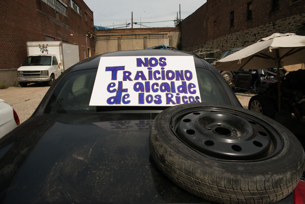 Shop owners displaced from Willets Point are now being evicted from their Hunts Point shop. A sign, which translates to