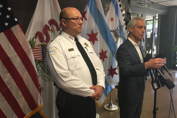 Flanked by First Deputy Police Supt. Kevin Navarro, Mayor Rahm Emanuel said the Police Department's new policy is in