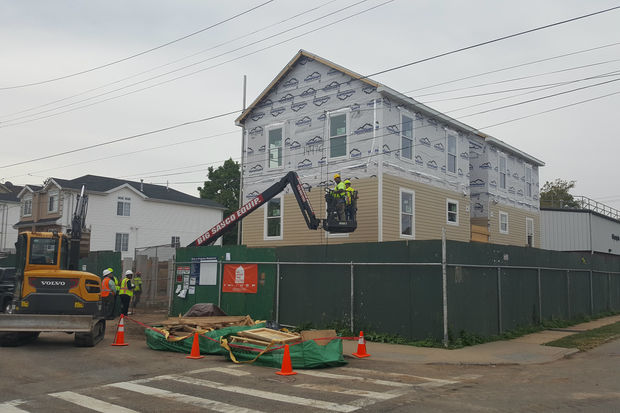 The city worked on installing a prefabricated hom at 137 Freeborn St. to replace it with one damaged by Hurricane Sandy.