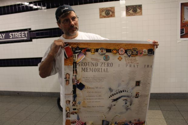 Keith De Cesare with a copy of the print that were taken from his unauthorized subway display in the World Trade Center subway station.