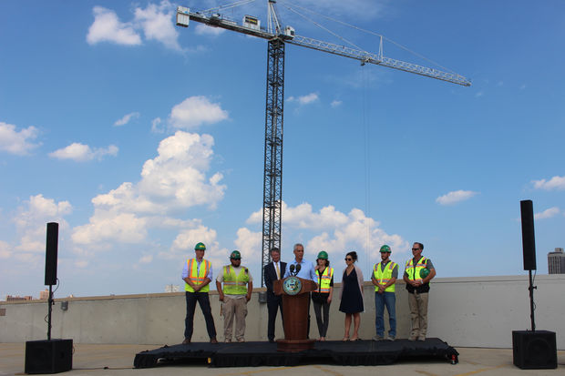 Backed by McCaffery President Ed Woodbury, Buildings Commissioner Judith Frydland and Lincoln Common construction workers, Mayor Rahm Emanuel says each construction crane represents about 1,000 jobs.