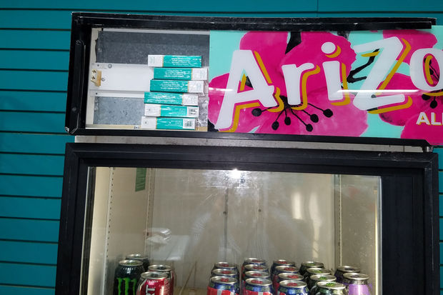 A cache of untaxed cigarettes was found behind the sign of a cooler at a convenience store in South Shore.