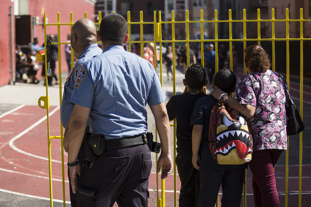 Police and others at the Urban Assembly School for Wildlife Conservation, a middle and high school that shares a building with P.S. 67.