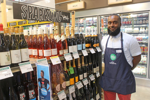 Lamar Harvey is specialty team leader. He helps host a weekly wine tasting event every Friday with live music.