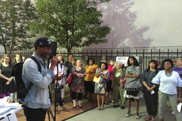 Poet Cyrus Aaron speaks at a rally against hate outside the Brooklin Library Branch of the Brooklyn Public Library Thursday, organized to denounce the hanging of a noose outside the library on Sept. 14.