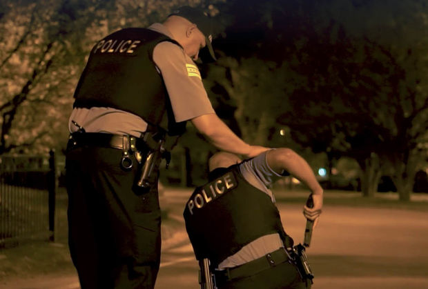 A police officer consoles another officer in this shot from a video made by the Chicago Police Department.